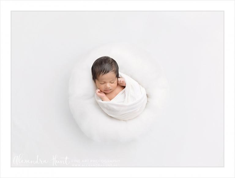 all white newborn baby photography setup